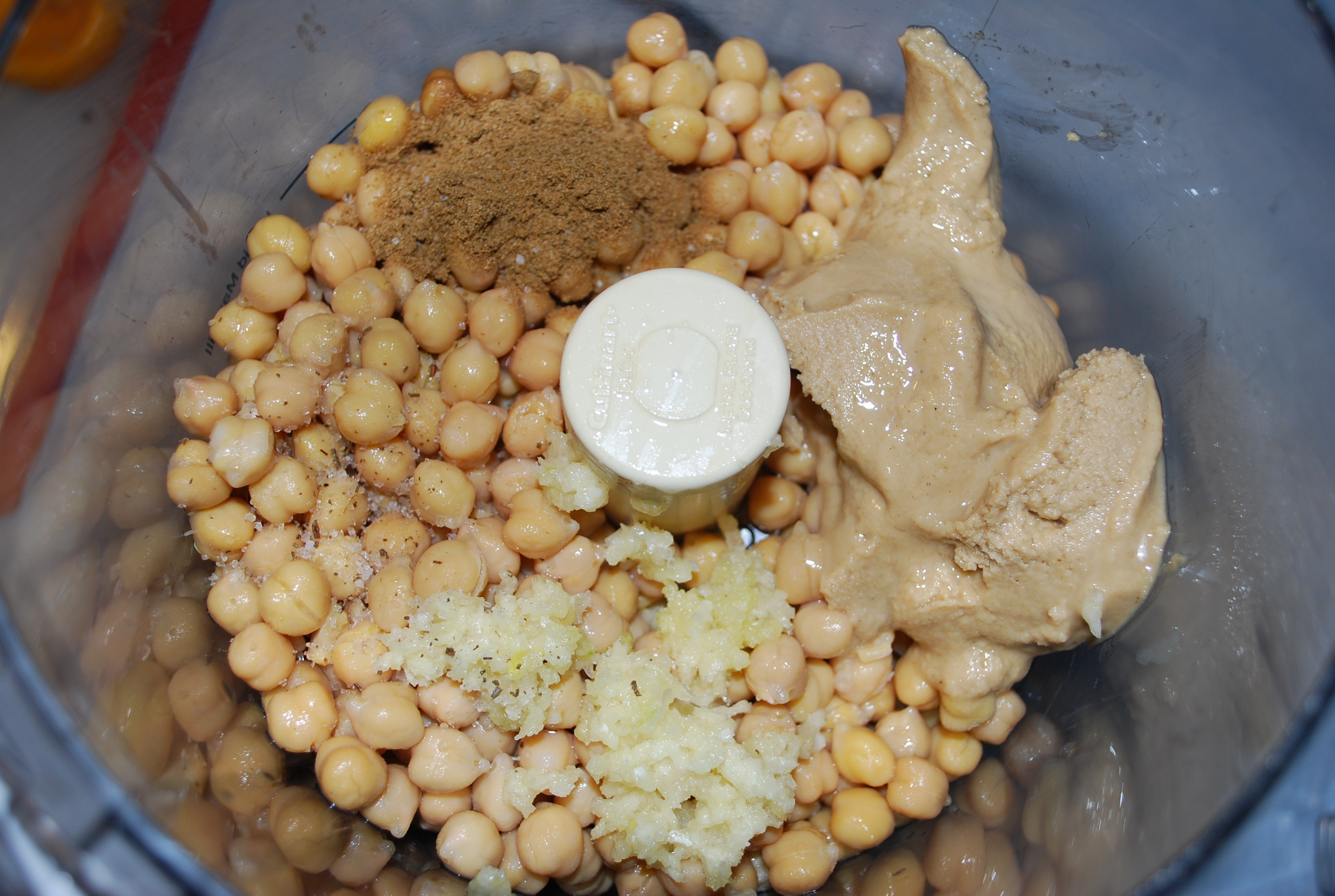 Blend ingredients in food processor until it reaches your desired consistency - use bean liquid or water to thin it out.
