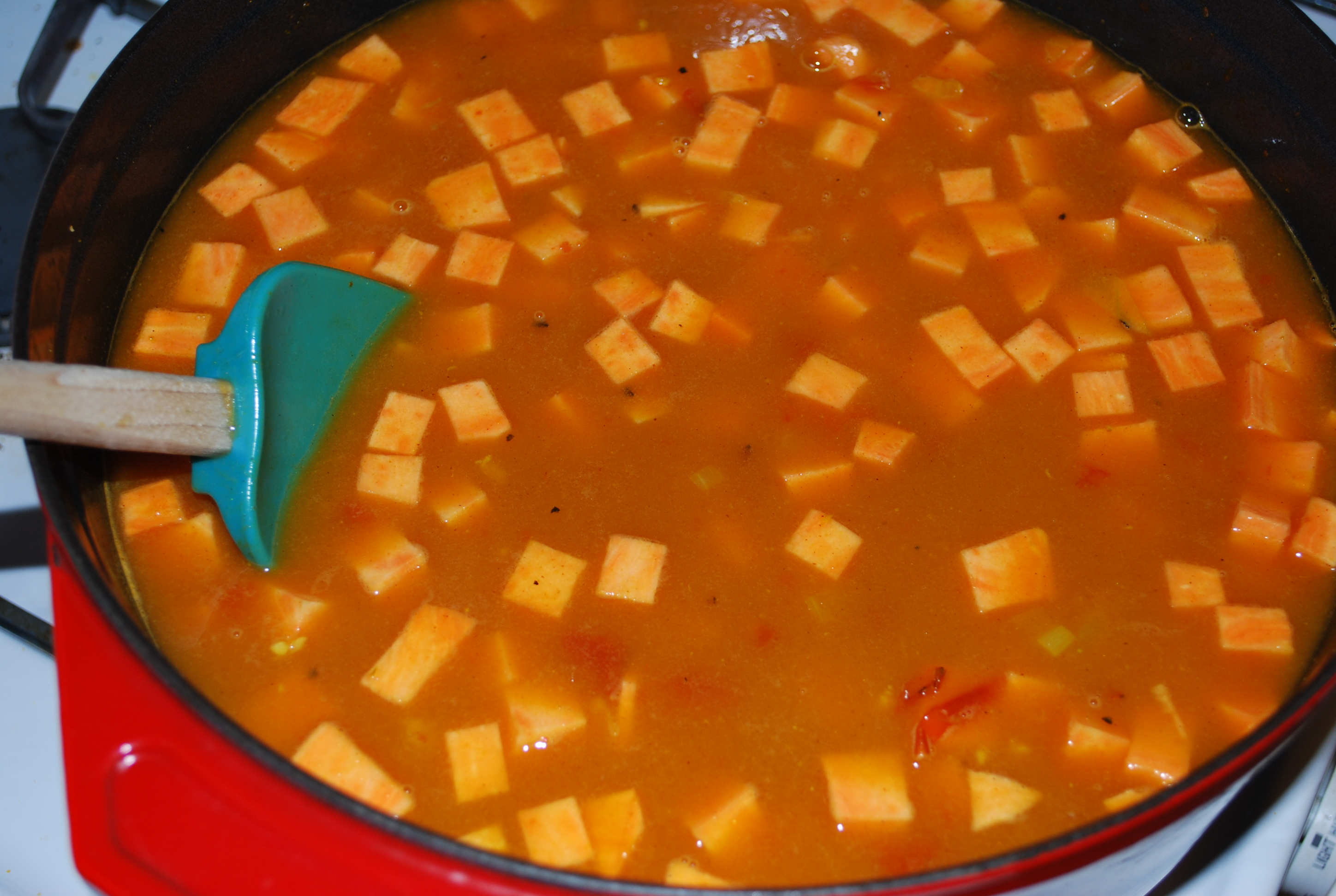 Add broth/water, lentils and sweet potatoes. Bring to a boil, reduce to low and cover. Cook for about 20-25 minutes or until potatoes and lentils are soft.